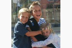 When a hug is all that is asked of you.....Sebastian Yanquelevech, centre, gets a hug from siblings Julien and Mia. Sebastian will have surgery to remove a brain tumour on March 5.
