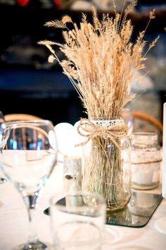 Twine, wheat, and mason jar centerpieces. | Photography by kimpayantphotography.com