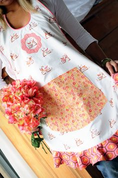 Country style apron with large front pocket and ruffle edge.