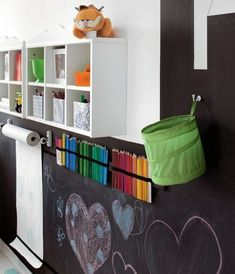 Bonus Room Must Do...Craft/Art Area. Paint chalkboard paint on wall. Hang a roll of white butcher paper with colored pencils or crayons. Shelves above provide perfect storage solution too.