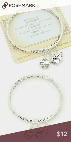 "🆕Teacher's Charm Bracelet🆕 This beautiful mobius style bangle is an eternal loop so the message is inscribed on all sides of the bracelet and is never ending. This twisted style bracelet is adorned with an opened book, cute apple charm with the word #1 teacher accented, and a silver-tone bead.  Serenity prayer card and gift box included. 🎁  ✔ Color: White and Antique Silver ✔ Size : 1"" L, 2.5"" Diameter  ✔ Imported   ➡ Savings Tip:  Bundle with other items to receive 10% off entire order…"