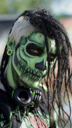 Halloween or Day of the Dead Makeup Idea for Men: A green skull face will add fright to your night.