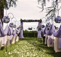 Outdoor Wedding On a Budget ...shepherd hooks with hanging flowers and tulle...