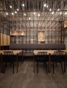 Lukstudio suspends metal wires to look like drying noodles at Chinese restaurant