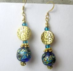 Blue lampwork with gold round charm dangle earrings by beadwizzard