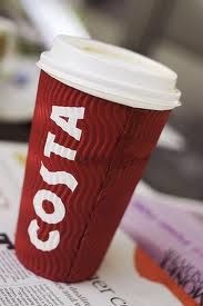 Walking down a cold street with a Costa Coffee