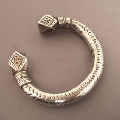 Africa | Silver bracelet sourced in the Middle Atlas Mountain range, Morocco.  ca first half of the 20th century | These bracelets are also found in Nubia and are often worn as anklets in Sudan and by the Tuareg people of Mali and Niger | 620€