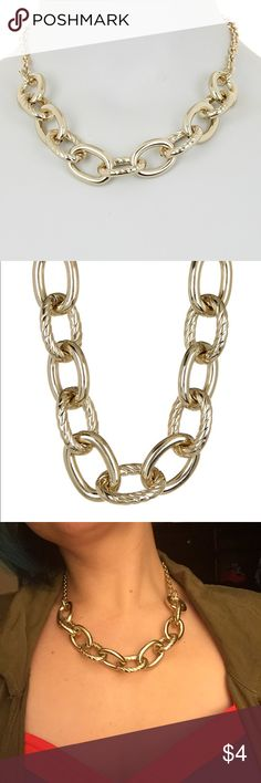 NWOT Small Chain Link Metal Necklace Gold colored chain necklace. Not really my style and I don't have space for it on my jewelry tree. Great for an office look. Never worn. Price is firm unless bundled with other items (and then it's basically free lol.) Natasha Accessories Jewelry Necklaces