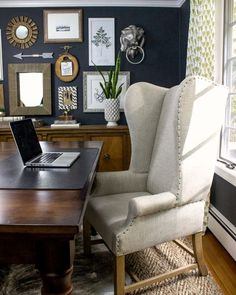Dramatic dark walls in this home office with large desk and wing back chair eclecticallyvintage.com