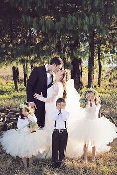 Photobombed by the ring bearers and flower girls! We love this silly photo.