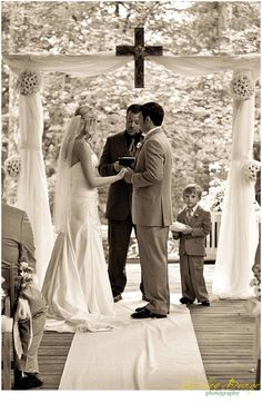 wedding arbor - must have a cross top center - keeping faith in the middle :)