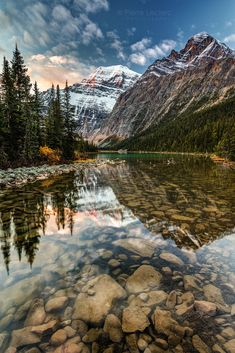 Mount Edith Cavell reflected in the calm river at sunrise in the rocky mountains of Jasper National Park, Alberta, Canada. Another Iconic Canadian Rockies scenery. by Pierre Leclerc Photography Beautiful World, Beautiful Places, Beautiful Pictures, Beautiful Scenery, Landscape Photography, Nature Photography, Travel Photography, Nature Pictures, Amazing Nature