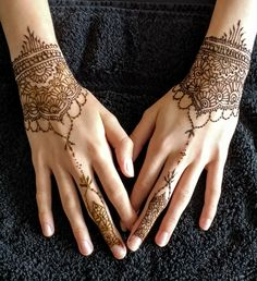 Delicate wrist and finger henna design