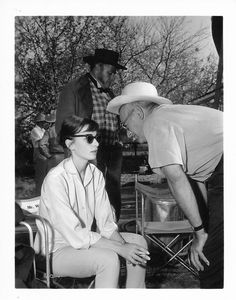 Audrey Hepburn and director William Wyler on the set of Love in the Afternoon, 1956.