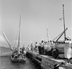 Locals gather at the dock in Charlotte Amalie, St. Thomas, US Virgin Islands.