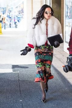 printed skirt and fur coat | 11 best streetstyle looks for women over 40 during New York Fashion Week featuring prints | 40PlusStyle.com