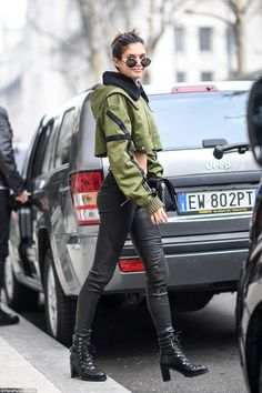 Smiley: She also sported black ankle boots and a pair of aviator sunglasses in a rounder design