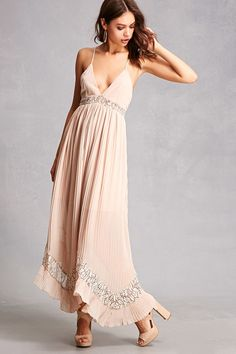 aabe34518e24 A woven maxi dress by Selfie Leslie™ featuring semi-sheer floral lace  paneled detailing