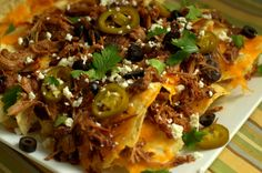 Double-Decker Pulled Pork Nachos with Smoked Cheese (shows how to smoke the cheese on the traeger)