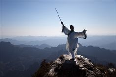 The legend, Zhang San Feng, here portrated by a local Kung Fu disciple, practicing Wudang Jian (sword) displaying grace, power and balance on top of a cliff opposite Tianzhu Peak.