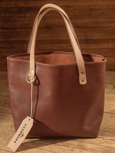 Best 12 A spacious tote x x constructed of one solid piece of top-grain leather, hand stitched with sturdy waxed thread at all structural seams for added longevity and durability. Solid brass rivets secure belt-weight veg-tan handles, a brass Cheap Purses, Cheap Handbags, Cheap Bags, Cute Purses, Luxury Handbags, Fashion Handbags, Tote Handbags, Purses And Handbags, Spring Handbags