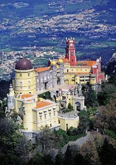 The Pena National Palace in Sintra, Portugal. My hubby took our children and his father to Portugal. He had seen this colorful castle from my book and they ended up touring it. Portugal Travel, Spain And Portugal, Portugal Destinations, Algarve, Places Around The World, Around The Worlds, Wonderful Places, Beautiful Places, Places To Travel