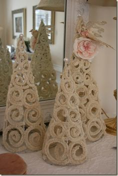 Christmas trees formed from chenille sticks on styrofoam, glued, then form removed