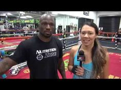 "Raquel Pa'aluhi demonstrates the ""arm spin"" on King Mo Lawal"