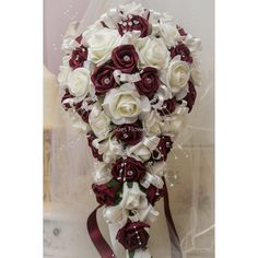 pics of brides with burgundy teardrop bouquet | Brides Teardrop Bouquet In Burgundy and Ivory.