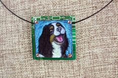 """King Charles Spaniel Hand-Illustrated Pendant – """"Sammie"""" - King Charles Spaniels wear their emotions on their faces, and Sammie is saying """"joy!"""" This unique colored pencil on copper illustration is mounted on circuit board. Show your love of this wonderful dog!"""
