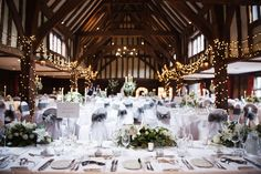 The Tithe Barn all set for a beautiful early Summer wedding photographed by Surrey wedding photographer Juliet Mckee. #greatfosters #GreatFostersweddings #GreatFostersweedingphotos #bridalprep #Surrey #wedding #photographers #barn #barnwedding #grandweddingvenues #weddingreception #bridalinspo #receptionideas #weddingideas #weddingstyle #greyandwhite #fairylights #toptable #weddingflowers #weddingphotographer