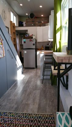 At $48,000, this modern-style tiny house is not exactly cheap, but it does display some rather nice attention to detail. To start, there's discreet under-stair storage (which is fixed on wheels for easy access), a folding wall-mounted table, and recessed lighting.