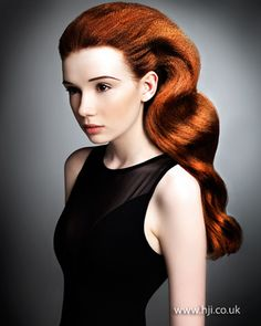 Long red hair was prepped with mousse and roughly blow-dried to add volume and texture.     Hairstyle by: Bree Davie and Alfie Booth  Hairstyle picture by: Russ Burton  Salon: Trevor Sorbie  Location: Hampstead, London