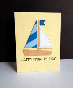 Father's Day Sailboat—using a new die from Paper Smooches with wood veneer paper for the boat, all layered 3 times.