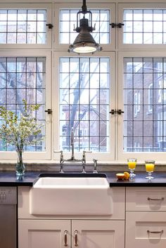 Love the windows, sink and lighting! | Industrial Kitchen by Nouvelle Cuisine