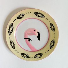 altered vintage decorative plate with sassy flamingo in white, pink, black, and pale yellow