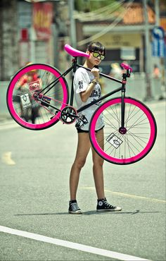 Girl + bike = I've recently added a pink and matte black fixie to my list of wants.  If a girl is going to maintain a healthier lifestyle, she should do it in style!!!!  Holla