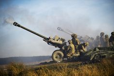 Soldiers of the Royal Artillery are pictured firing 105mm Light Guns during an exercise.