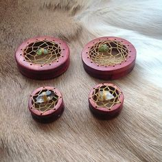 MADE TO ORDER Hand carved dreamcatcher wood eyelets plugs for gauged stretched ears. $100.00, via Etsy.