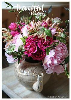 Seasonal wedding flowers in a vintage teapot from Thoughtful Flowers