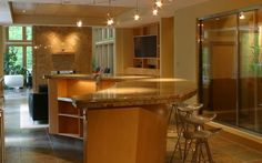 This lower level was remodeled and expanded to include a bar, wine cellar, living room and billiards area.