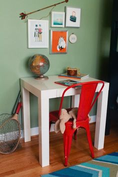 little desk, red chair, like the batman & robin print...(Jodi M. Photography via mustard seed)