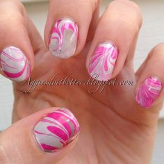 #31dc2013 #day20 #watermarblenails I LOVE LOVE water marble I just wish it wasn't so high maintence or I would do it every day! I tried a sparkly one in the mix- @chinaglazeofficial Ahoy along with grays Pelican Gray and Recycle #nails #nailart #aggies #pink