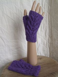 Hand knitted mittens :Hand knitted ladies' fingerless mitts. Practical and stylish, these versatile gloves make a great gift.One of a kind design hand made in Wales. £8.00, available from www.liliwenfachknits.co.uk