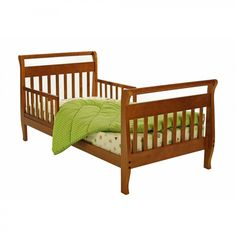 Looking for a transitional bed for your toddler? Look no further than the Sleigh Toddler Bed from Dream On Me! This solid wood bed features dual safety rails and a low height so that toddlers can easily climb in and out of bed. An ideal choice for toddler