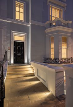 As the nights draw in, consider making your home more inviting. with lighting. Front Door Lighting, Entrance Lighting, Facade Lighting, Outdoor Lighting, Lighting Ideas, External Front Doors, Townhouse Exterior, Architectural Lighting Design, External Lighting