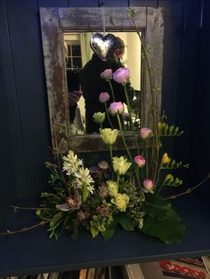 Parallel design - ranunculus roses hyacinths and freesias