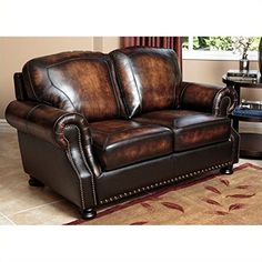 Abbyson Living Tannington Top Grain Loveseat in Brown. Offering a perfect mix of style and comfort, the Tannington leather living room series will add timeless luxury to one of the most important rooms in your home. This exquisite series features versatile furniture pieces that will be the highlight of any family or living room. Features: Designed in the USA; Material: Top grain genuine leather; Kiln dried hardwood, High resiliency foam cushioning, Hand stiched details; Seat height: 19...