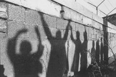 The Berlin Wall bears the shadowy silhouettes of West Berliners waving to their relatives on the unseen, Eastern side of the Wall in December 1962.