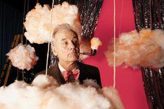 Bill Murray smoking a pipe amougst fake clouds.